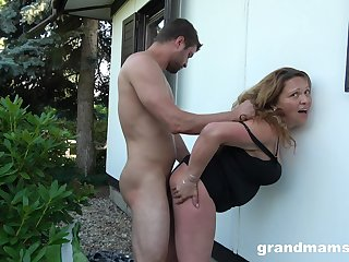 Lecherous housewife fucks a guy in the backyard while her hubby is clubby
