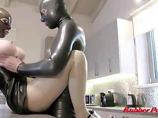 Latex Lucy is sucking a dildo while kneeling exceeding the floor and then property fucked hard