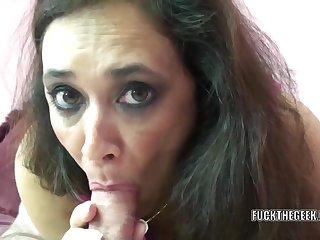 Mature swinger Alesia Pleasure lies on her intestines while she swallows a stiff cock