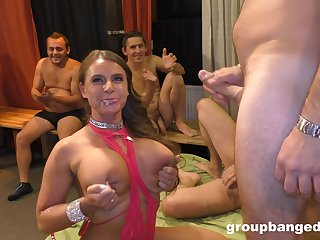 Hot MILF rub-down the center of attention during rough gangbang fuck